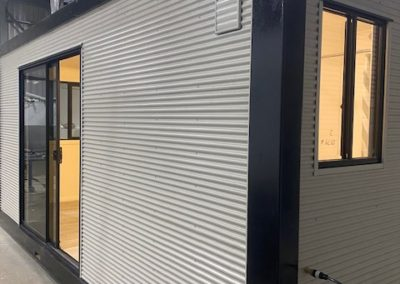 Colorbond protects the aluminium steel clad and insulated shipping container conversion into living room and bathroom