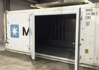 A refrigerated shipping container used as a Coolroom which has 2 new outward opening side doors installed for a client in Mildura