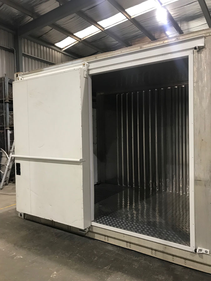 A refrigerated shipping container used as a Coolroom which has sliding door installed on the side for a client in BrokenHill