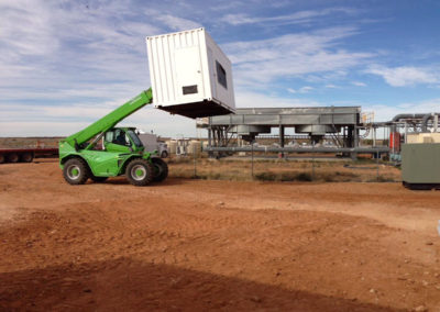Delivering modified shipping containers to Prom Hill Camp in the outback
