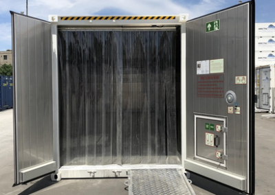 Shipping Container modification with fly curtain.