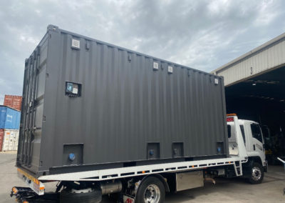 20ft shipping container ablution lifted onto the truck ready for delivery to site. G.A.A.S containers delivery nationally