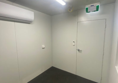 Inside 40ft shipping container modification to office and bathroom facility