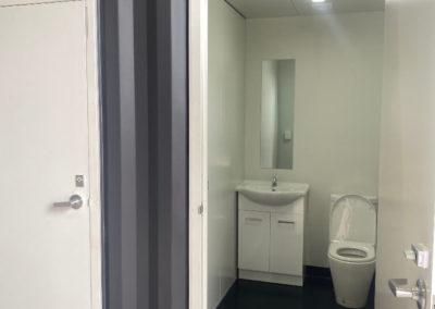 Internal bathroom fitout of toilet and basin part of a 20ft container ablution block