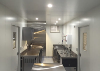 Internal view of stunning and functional 40ft kitchen and diner for remote outback camp
