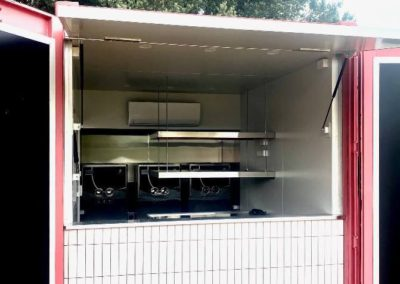 Shibui side opening awning design allows for more space and storage to the rear of the container
