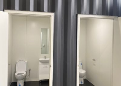 Shipping container toilets with basin