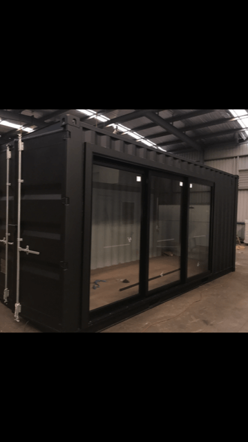 The 20ft shipping container room featuring glass sliding doors
